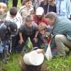 Former Mayor of Greater Sudbury releases fish in Junction Creek.
